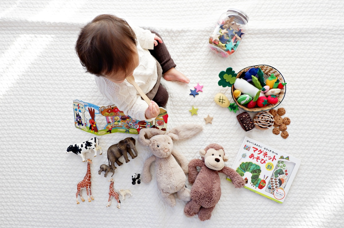 Kid On White With Toys